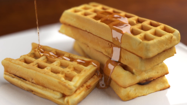 CGI syrup pouring over waffles. 3D animation